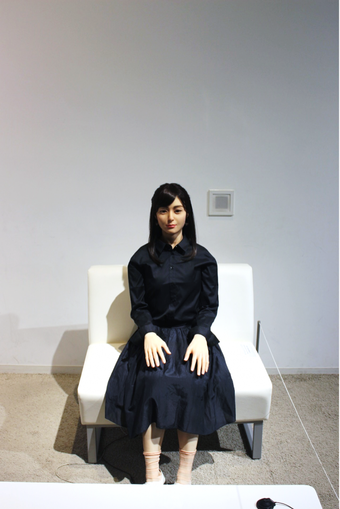 A female humanoid robot in the exhibit